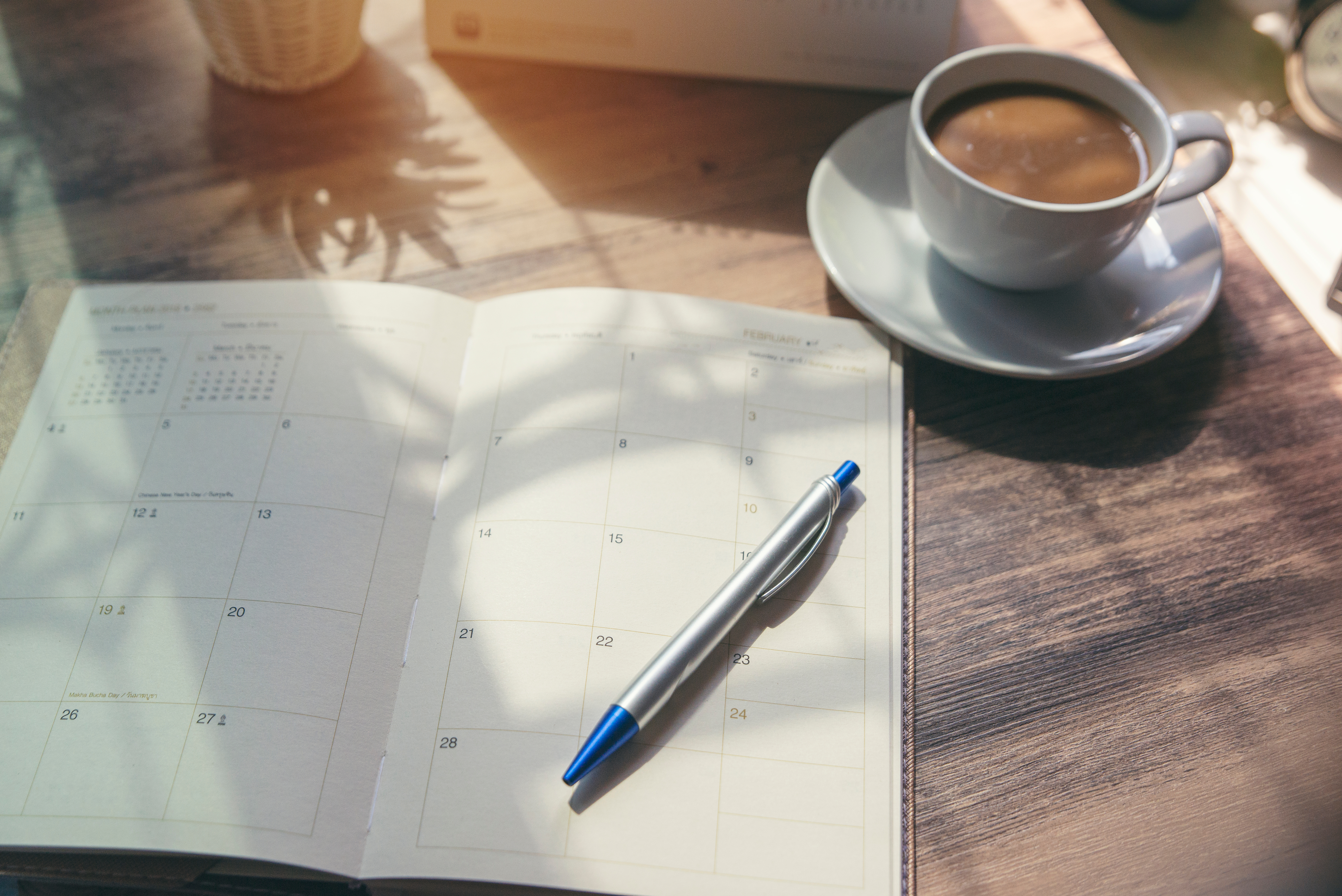 planner on a table with some coffee