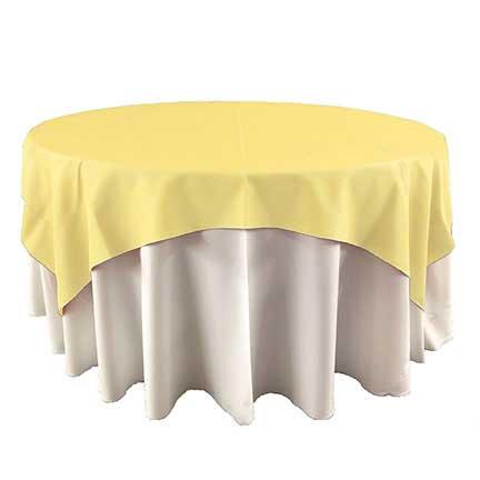Light yellow maize overlay linen for rent in Riverton Utah