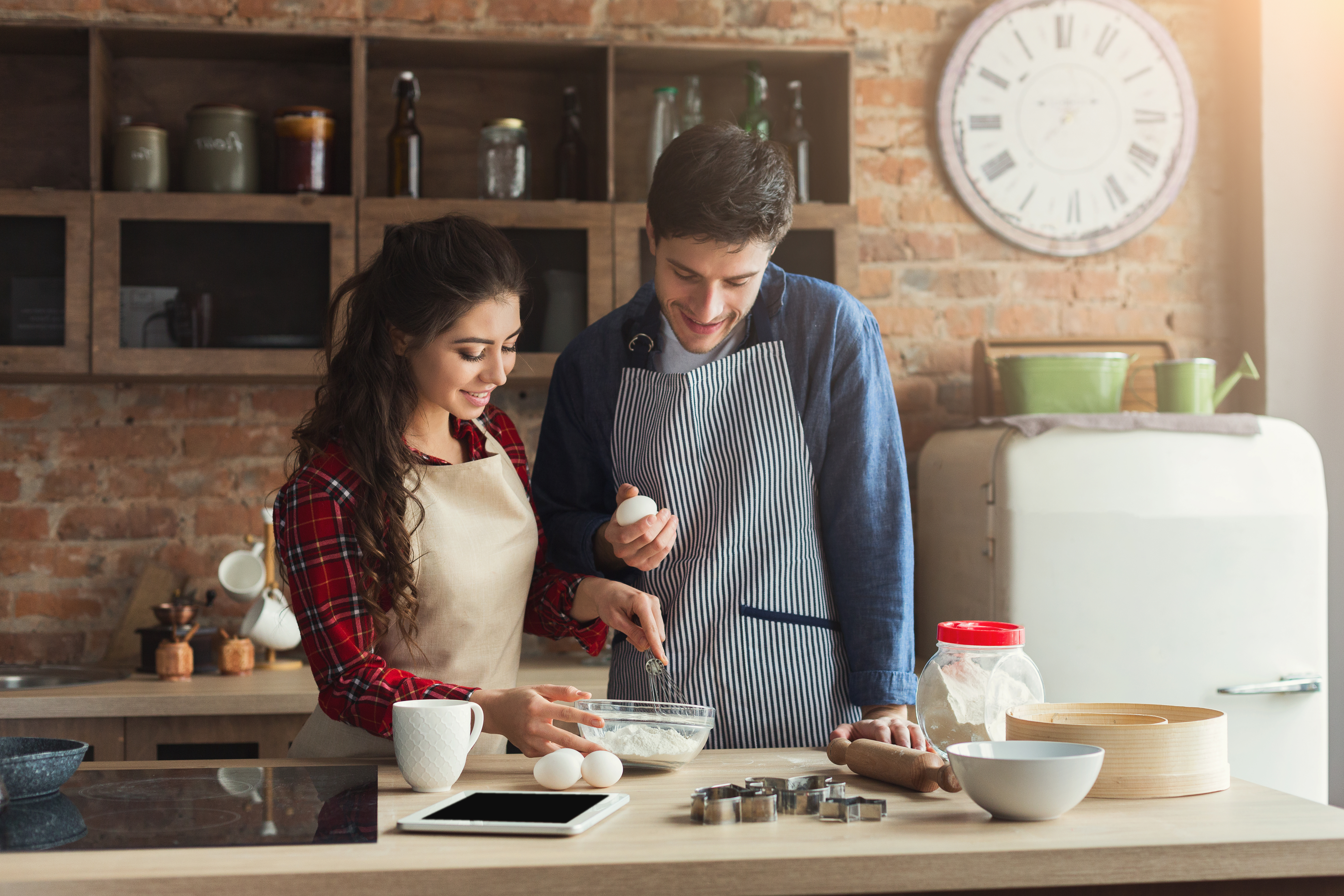 young couple baking together at home