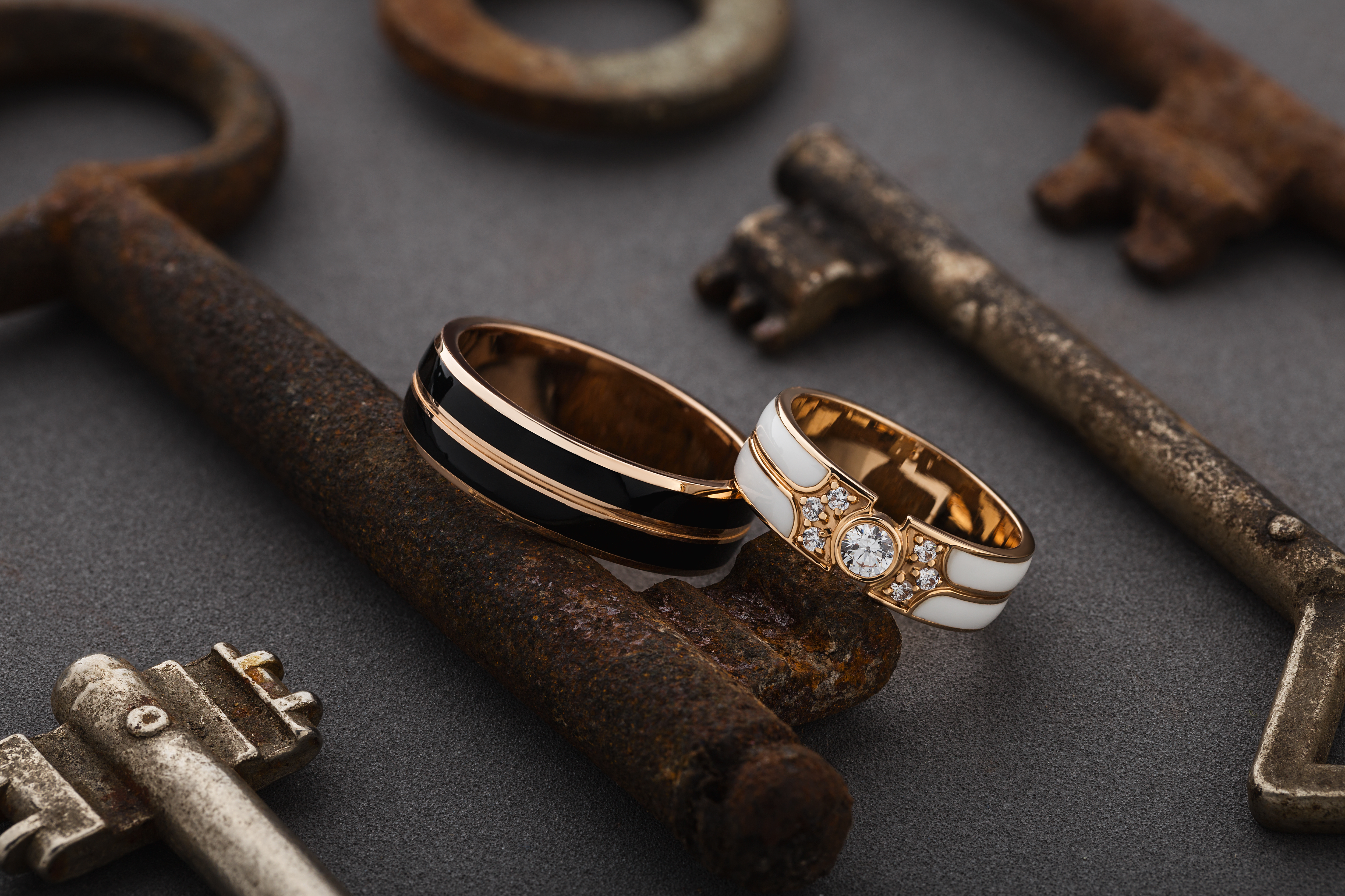 wedding ring on top of rusted keys on a table