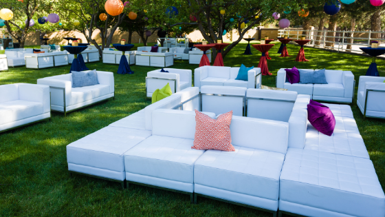 comfortable white sofas at an outdoor Utah wedding reception