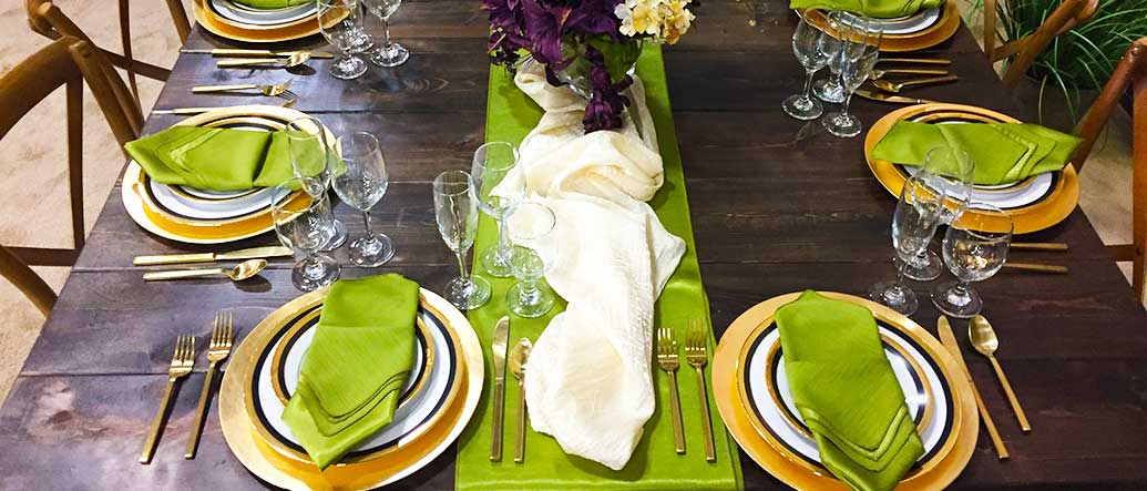 Table Setting with Gold colored China and Flatware for rent in Salt Lake City Utah