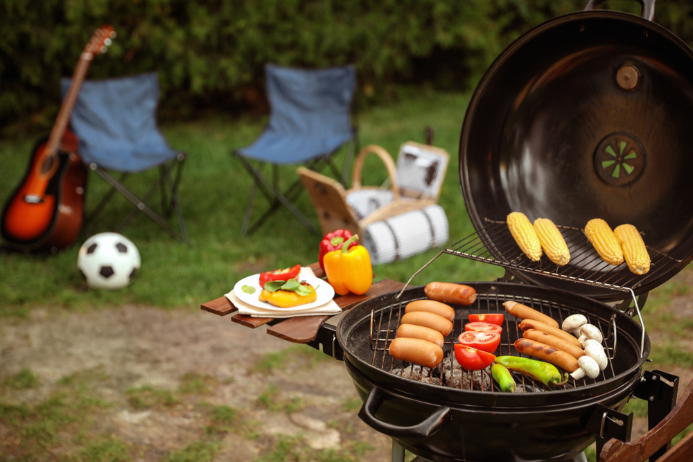 barbecue in the back yard with chairs with soccer ball and chairs