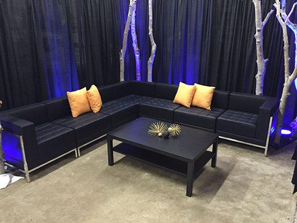 Black Coffee Table with Lounge and Trees Display Salt Lake City