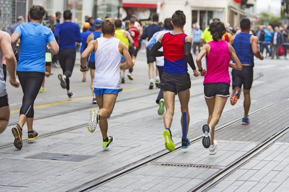 Runners in a marathon running away from perspective.