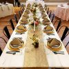 Whitewash Banquet Tables with gold table runner and gold china for rent in Salt Lake City Utah