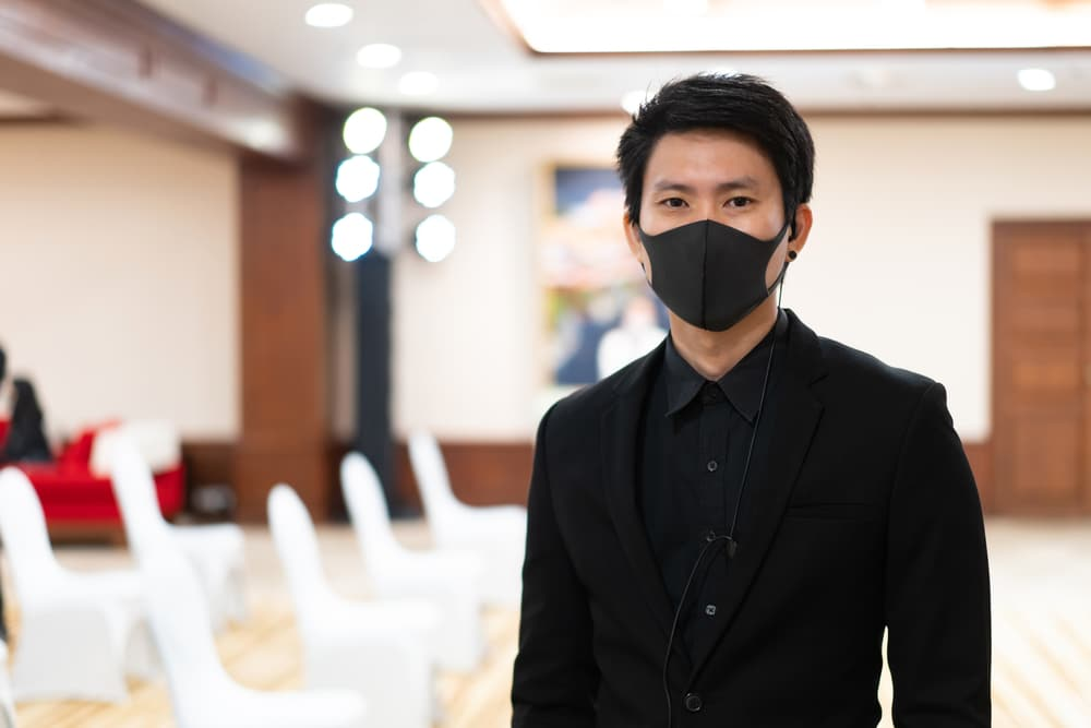 man in mask at an event